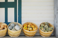 Gourds on Porch. Autumn gourds in baskets decorate a house porch Stock Photos