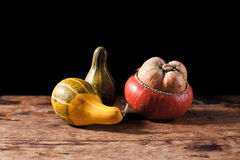 Gourds on wooden table Stock Photography