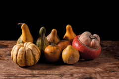 Gourds on wooden table Stock Images