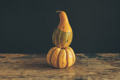 Gourds on wooden table Stock Photo