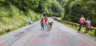 Kids Writing on the Road. Gourette, France, July 15th 2011:Kids writing on the road to mountain pass Aubisque,in Pyrenees Mountains, before the appearance of the Royalty Free Stock Photos