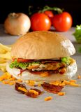 Gourmet American bacon and cheese burger Stock Photography