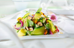 Gourmet Appetizing Fresh Green Salad. With Plenty Elements, on White Table Royalty Free Stock Photography