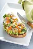 Gourmet avocado toast with caviar and radishes Royalty Free Stock Photos