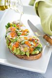 Gourmet avocado toast with caviar and radishes Royalty Free Stock Images