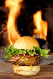 Gourmet bacon cheeseburger with lettuce and tomato Royalty Free Stock Photos