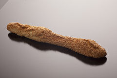 Gourmet baguette lavishly coated with sesame Royalty Free Stock Photos