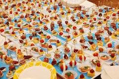 Gourmet banquet table at an exclusive party. Buffet of the restaurant which has prepared catering from salads and cold snack for the forthcoming celebration Royalty Free Stock Photos