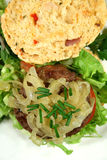 Gourmet Beef Burger On A Herb Roll Stock Image