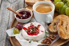 Gourmet breakfast- camembert with berry jam, toast, coffee Stock Photos