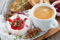 Gourmet breakfast- camembert with berry jam, toast, coffee Royalty Free Stock Image