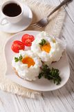 Gourmet breakfast: eggs Orsini and coffee close-up. Vertical Royalty Free Stock Photos