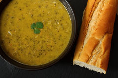 Gourmet broccoli and stilton soup. Bowl of broccoli and stilton soup with crusty french bread Stock Photography