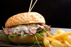 Gourmet burger with roast beef and chips Royalty Free Stock Images