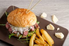 Gourmet burger with roast beef and chips Royalty Free Stock Photo