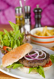 Gourmet burger with salad and fries Royalty Free Stock Photos