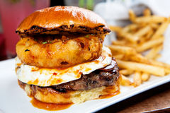 Free Gourmet Burger With Fried Egg And Onion Ring Stock Image - 67714831