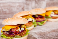 Gourmet burgers on wooden plate Stock Image