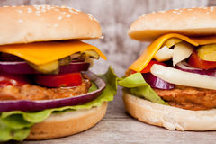 Gourmet burgers on wooden plate Stock Photo