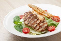 Gourmet caesar salad with grilled meat fillet, cherry tomatoes, Royalty Free Stock Image