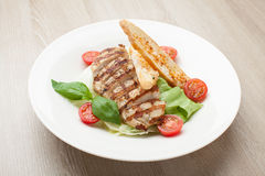 Gourmet caesar salad with grilled meat fillet, cherry tomatoes, Stock Photos