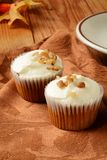 Gourmet carrot cupcakes. With nuts and a cup of coffee Royalty Free Stock Photography