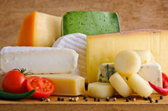 Gourmet cheese. Background with gourmet cheese on a wooden table Stock Photography