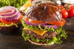 Gourmet Cheese Burger on a Pretzel Roll Royalty Free Stock Photos