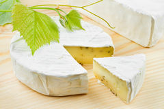 Gourmet cheese and grapes Stock Images