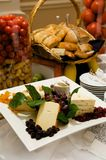 Gourmet cheese plate with garnishes Stock Image