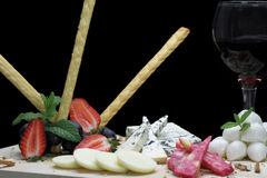 Gourmet cheese platter. On black background Stock Photos