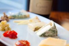 Gourmet Cheese Platter. Cheese Platter with five cheeses and jellies Royalty Free Stock Image