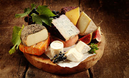 Gourmet cheese platter on a rustic buffet Royalty Free Stock Photography
