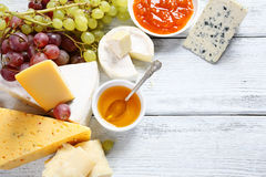 Gourmet cheeses with honey Royalty Free Stock Image