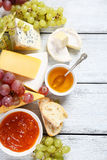 Gourmet cheeses with honey and jam Royalty Free Stock Image