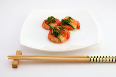 Gourmet chinese food - broiled king tiger prawns on white. Gourmet chinese food, tiger king prawns served with a vegetables and tomato garnish with copy space Stock Images