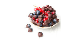 Gourmet chocolate covered berries. On the plate stock images