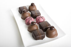 Gourmet Chocolates on Glass Platter Royalty Free Stock Photography