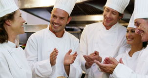 Gourmet cook applauding their colleague stock video footage