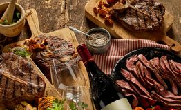 Gourmet cooked meats and fine dining crockery stock photography