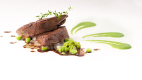 Gourmet cow liver with green peas Royalty Free Stock Photography