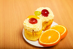 Gourmet cream cake cookie and orange on plate Stock Photography