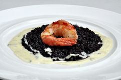 Black risotto and shrimp, Italian creative food Stock Images