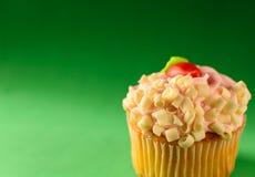 Gourmet Cupcake  on Green Background Stock Photo