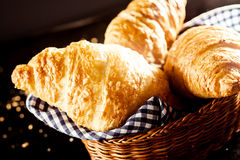 Gourmet Delicious Croissant on Bread Basket Stock Images
