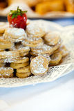 Gourmet Delicious Macarons with Sugar on a Plate Royalty Free Stock Images