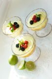 Gourmet dessert- strawberry souffle with lemon liquire and berries Stock Photos