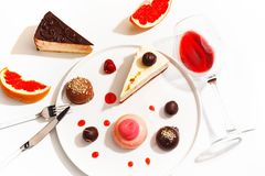Gourmet desserts and grapefruit slices on a white plate. Top view stock photography
