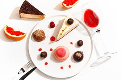 Gourmet desserts and grapefruit slices on a white plate. Top view stock photo