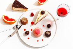 Gourmet desserts and grapefruit slices on a white plate. Top view royalty free stock image